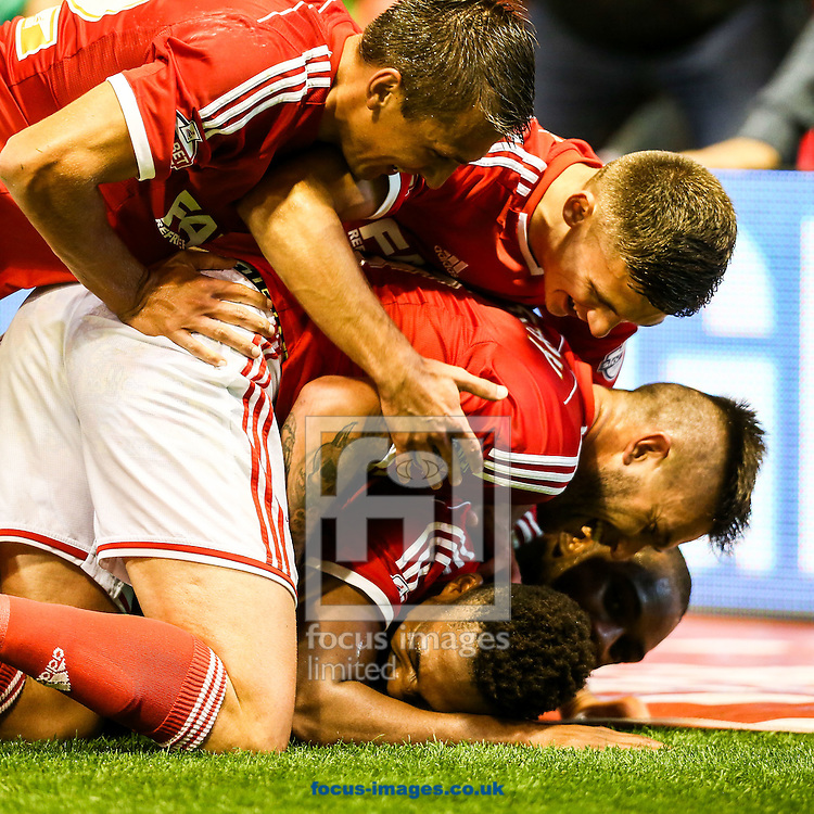 Britt Assombalonga of Nottingham Forest (bottom) celebrates after scoring the fourth goal for Forest during the Sky Bet Championship match at the City Ground, Nottingham<br /> Picture by Andy Kearns/Focus Images Ltd 0781 864 4264<br /> 17/09/2014