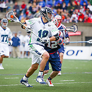 Ben Hunt #18 of the Chesapeake Bayhawks controls the ball during the game at Harvard Stadium on April 27, 2014 in Boston, Massachusetts. (Photo by Elan Kawesch)