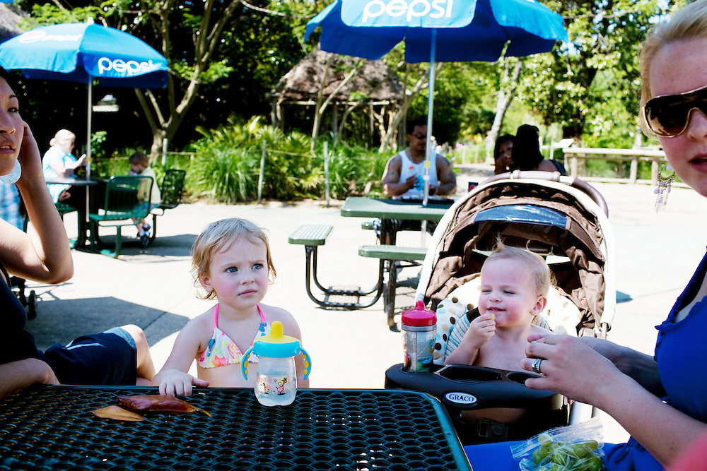 Madelyn Avery Eich, 2, sits with friends while taking a snack break at The Norfolk Zoo on Saturday, May 1, 2010.