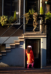 NETHERLANDS AMSTERDAM 02JAN09 - Young girl enters a house in Amsterdam's red light district...jre/Photo by Jiri Rezac