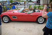 Kevin Sheely sits in a replica of the 1961 Ferrari before the Shermer High School 1986 Spring Dance that's part of the Ferris Fest at the Athletico Center on, Friday, March 20, 2016, in Northbrook. (Photo by Rob Hart)