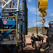 Roughnecks install a secondary rig near Trenton, North Dakota. The oil boom is redrawing North Dakota's landscape and creating opportunity for thousands of unemployed Americans. However, the economic prosperity has exacerbated problems in housing, infrastructure and traffic...Known for the beauty of its great plains, North Dakota has long been the least populated state in the country. Because of the Bakken oil boom, everyday, mostly men, pour in from across the nation looking for work. The small town of Williston has exploded as a result. Ten years ago Williston, North Dakota was a quiet agricultural town with a population around 12,000. In a decade the population has more than doubled to over 30,000. More than half of Williston's residents now work in oil-related jobs and the city's unemployment rate is at 1 percent, which is the lowest in the U.S...