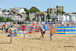 Holidaymakers on the beach at Viking Bay in Broadstairs, Kent.