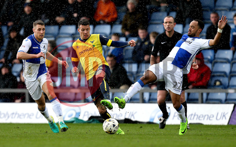 Byron Moore of Bristol Rovers and Marvin Johnson of Oxford United battle for the ball - Mandatory by-line: Robbie Stephenson/JMP - 04/03/2017 - FOOTBALL - Kassam Stadium - Oxford, England - Oxford United v Bristol Rovers - Sky Bet League One