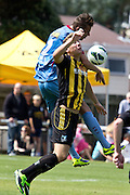 Aaron Jones (Hawkes Bay) and Sam Mason'Smith clash. Team Wellington v Hawkes Bay United, ASB Premiership semi final at David Farrington Park, Wellington. 8 March 2014. Photo: Cameron McIntosh/www.photosport.co.nz