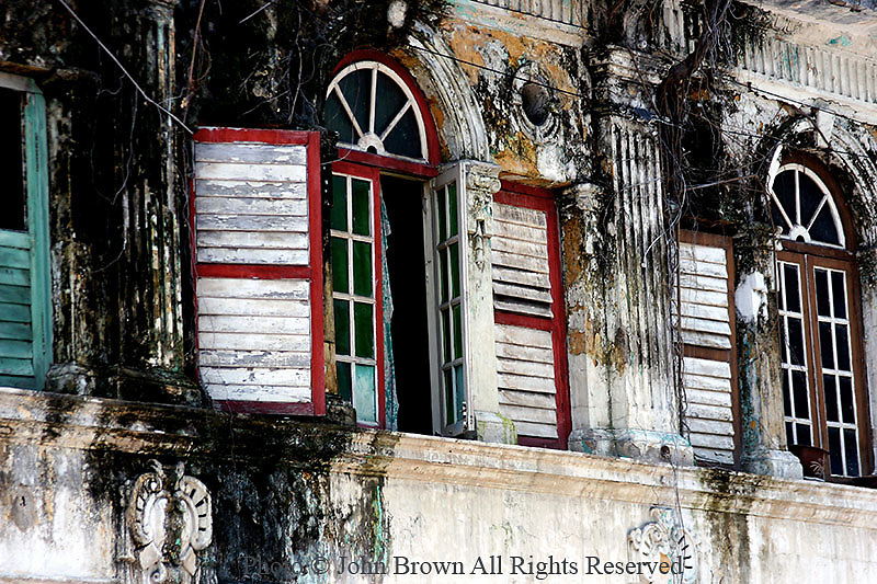 The architectural influence of British colonialism is displayed in this rundown and dilapidated building in Georgetown, Penang, Malaysia.