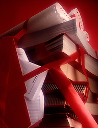 Cluttered assortment business documents wrapped in red tape.