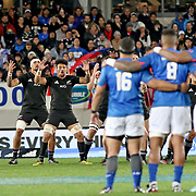 With Samoa flags to their back, the NZ All Blacks respond to Samoa's Siva Tau with their legendary Haka.  The New Zealand All Blacks defeated Manu Samoa 15's 83-0 at Eden Park, Auckland, New Zealand.  Photo by Barry Markowitz, 6/16/17