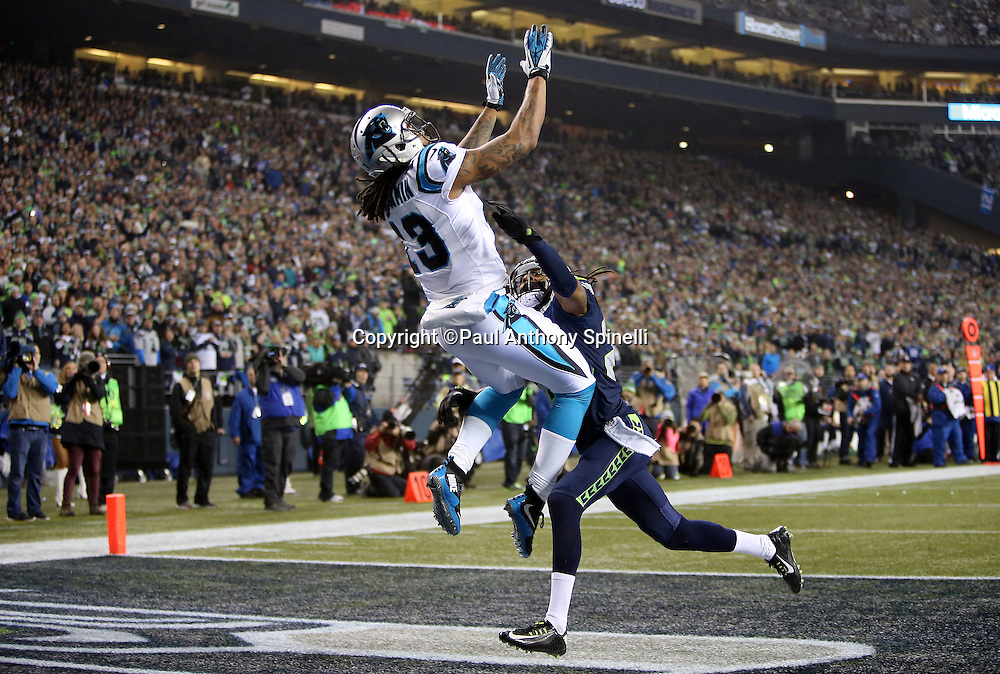 Carolina Panthers wide receiver Kelvin Benjamin (13) is covered by Seattle Seahawks cornerback Richard Sherman (25) as he leaps high in the air and catches an end zone pass subsequently ruled out of bounds late in the second quarter during the NFL week 19 NFC Divisional Playoff football game against the Seattle Seahawks on Saturday, Jan. 10, 2015 in Seattle. The Seahawks won the game 31-17. ©Paul Anthony Spinelli