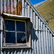 Weathered exterior of a sheep station hut high in the Arrowsmith Range, South Island, New Zealand. Photo by Jen Klewitz