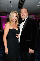 British fine jewellery brand Boodles welcomed guests for the 2013 Boodles Boxing Ball in aid of Starlight Children's Foundation held at the Grosvenor House Hotel, Park Lane, London on 21st September 2013.<br /> Picture Shows:-MARK DENNEY and JOELINE GARNER-JOEL.<br /> <br /> Press release - https://www.dropbox.com/s/a3pygc5img14bxk/BBB_2013_press_release.pdf<br /> <br /> For Quotes  on the event call James Amos on 07747 615 003 or email jamesamos@boodles.com. For all other press enquiries please contact luciaroberts@boodles.com (0788 038 3003)