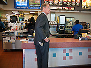31 OCTOBER 2010 - WINDOW ROCK, AZ: Terry Goddard orders a coffee at the McDonald's in Window Rock. Goddard, and the other Democrats on the statewide ticket, campaigned in Window Rock and Kingman on Halloween. Goddard ended the day with a press conference in front of the Executive Office Tower at the State Capitol in Phoenix. Goddard lost the election to sitting Governor Jan Brewer, a conservative Republican.     PHOTO BY JACK KURTZ