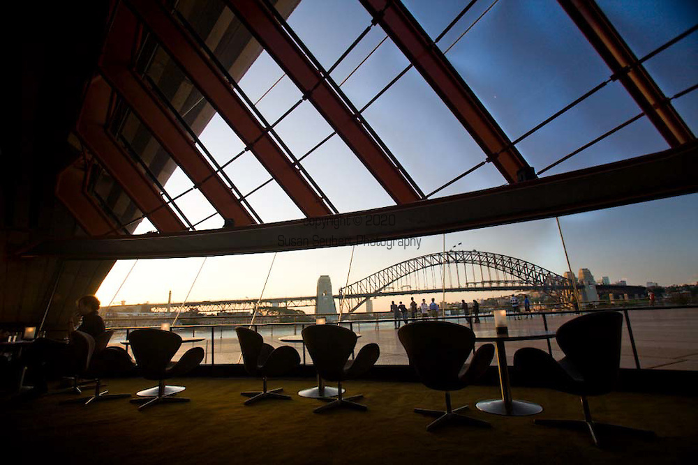"""Guillaume at Bennelong, is situated in the southern most shell of the Sydney Opera House.  Diners sit beneath Jorn Utzon's vaulted concrete """"ribs."""" Both the restaurant and the bar offer spectacular views of Sydney Harbour, the city, the Harbour Bridge, Sydney Botanic Gardens and the Circular Quay."""