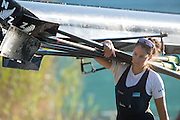 Aiguebelette, FRANCE, NZL Women's crew member carries the blade/oars from teh dock    2015 FISA World Rowing Championships, <br /> Venue, Lake Aiguebelette - Savoie. <br /> Sunday  30/08/2015  [Mandatory Credit. Peter SPURRIER/Intersport Images].