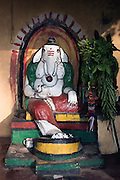 Ganesh shrine on a road beside irrigation canal at Wilgamuwa.