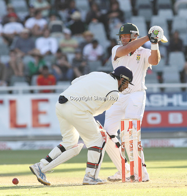 CAPE TOWN, SOUTH AFRICA - 2 January 2011, Jacques Kallis of South Africa gets the ball past Indian Captain Mahendra Singh Dhoni during day 1 of the 3rd Castle Test between South Africa and India held at Sahara Park Newlands Stadium in Cape Town, South Africa on the 2 January 2011 .Photo by: Shaun Roy