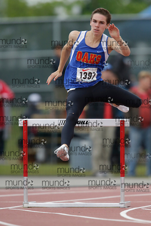 Davis Edward of Oakridge SS - London competes in the intermediate hurdle heats at the 2013 OFSAA Track and Field Championship in Oshawa Ontario, Saturday,  June 8, 2013.<br /> Mundo Sport Images/ Geoff Robins