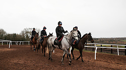 Race horses from a yard in Worcestershire leave the gallops. An outbreak of equine flu has forced the cancellation of all British racing on Thursday.