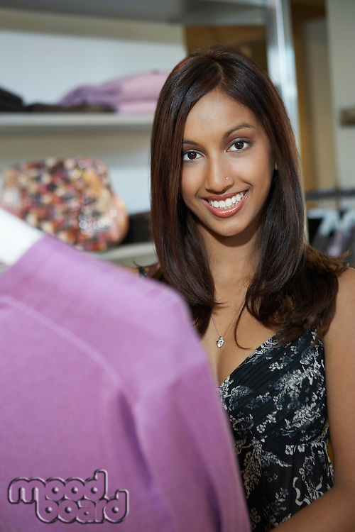 Portrait of woman at clothes shop