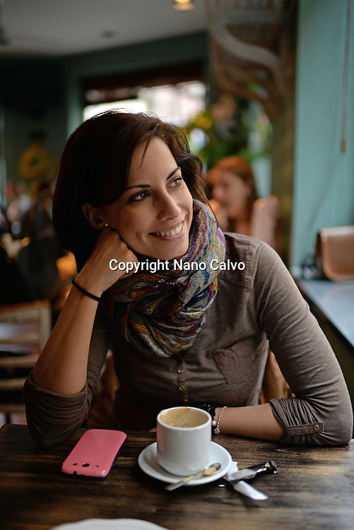 Portrait of young attractive woman in a cafe