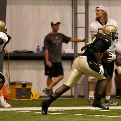 08 August 2009: New Orleans Saints safety Roman Harper (41) is chased by wide receiver Courtney Roby (15) after an interception during the New Orleans Saints annual training camp Black and Gold scrimmage held at the team's indoor practice facility in Metairie, Louisiana.