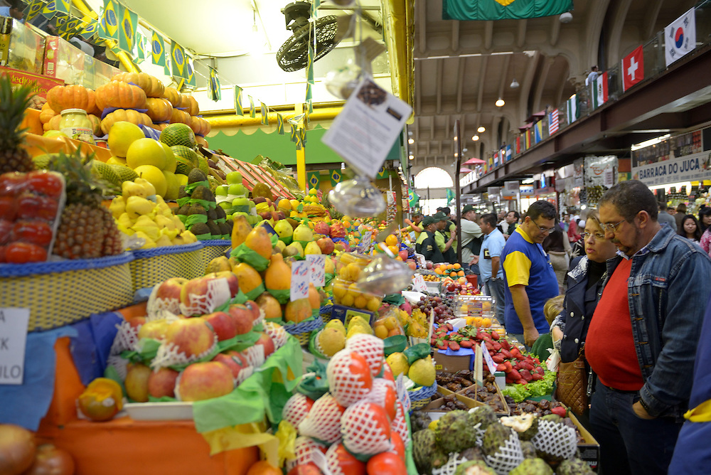 SAO PAULO, BRAZIL - June 19, 2014: A fruits stand in Mercado Municipal, one of Sao Paulo's largest food markets. World Cup to kick up prices in inflation-weary Brazil. The arrival of roughly 600,000 foreign tourists for the tournament will likely cause substantial increases in the prices of airline tickets, restaurant meals and hotel rooms. Photo by Gili Yaari