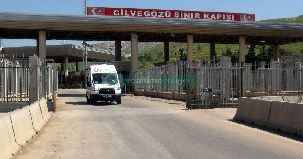 April 4, 2017 - Hatay, Hatay Province, Turkey - Ambulance rushes to help victims of a deadly nerve gas attack (possibly the powerful and lethal sarin nerve gas) in north-western Syria. First reports place the death toll at 70 to 100, many childern. Several reported that airstrikes had targeted clinics treating the wounded. Khan Sheikhoun, Idhib Province is a rebel-held town of 165,000. Around 30 Turkish ambulances came to the border in Hatay Province, Turkey for medical evacuation of victims after the Syrian toxic gas attack, then to be brought to Turkish medical aid. (Credit Image: © Ferhat Dervisoglu/Depo Photos via ZUMA Wire)