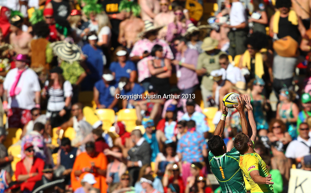 South Africa's Chris Dry and Australia's Sean McMahon compete for a high ball. Hertz Wellington Sevens - Day Two at Westpac Stadium, Wellington, New Zealand on Saturday 2 February 2013. Photo: Justin Arthur / photosport.co.nz
