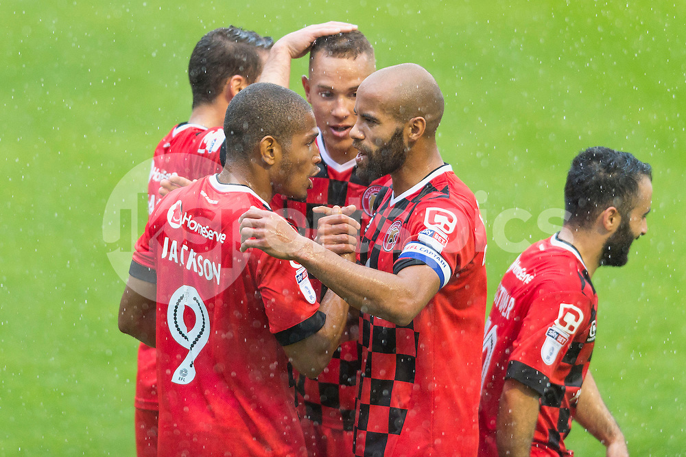 Simeon Jackson of Walsall celebrates scoring his sides third goal with team mates during the EFL Sky Bet League 1 match between Walsall and Bury at the Banks's Stadium, Walsall, England on 27 August 2016. Photo by Darren Musgrove.
