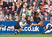2005/06 National League One, NEC Harlequins vs Exeter, Twickenham Stoop, Twickenham, ENGLAND: Ugo Monyye attacking down the wing, breaks Garth mason diving tackle.   22.10.2005   © Peter Spurrier/Intersport Images - email images@intersport-images..   [Mandatory Credit, Peter Spurier/ Intersport Images].