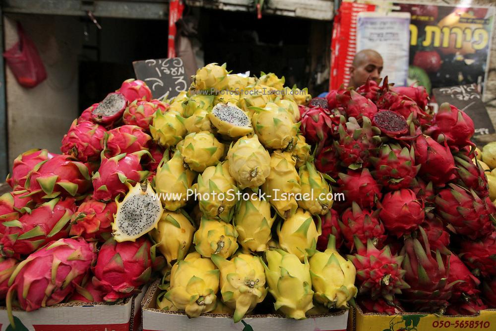 A market stall selling yellow and red pitaya