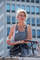 © Licensed to London News Pictures. 15/07/2019; Bristol, UK. DR GAIL BRADBROOK, co-founder of Extinction Rebellion speaking at the XR Summer Uprising 2019. Extinction Rebellion start their week of action by occupying Bristol Bridge in the city centre and traffic has to be diverted. Extinction Rebellion are holding a five-day 'occupation' of Bristol. As part of a country-wide rebellion called Summer Uprising, followers will be holding protests in five cities across the UK including Bristol on the theme of water, which is the group's focus for the South West. The campaign wants the Government to change its recently-set target for zero carbon emissions from 2050 to 2025.<br /> In Bristol Extinction Rebellion plan a week-long occupation of Bristol Bridge in the city centre from Monday and organisers anticipate more than 1,000 people will take part in the action. On Tuesday, they will occupy College Green in front of the city's council house before protesting outside the Ministry of Defence in Stoke Gifford on Friday Photo credit: Simon Chapman/LNP.