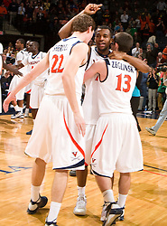 Virginia guard Jeff Jones (23) celebrates his team's win over VT with teammates forward Will Sherrill (22) and guard Sammy Zeglinski (13).  The Virginia Cavaliers defeated the Virginia Tech Hokies 75-61 at the John Paul Jones Arena on the Grounds of the University of Virginia in Charlottesville, VA on February 18, 2009.