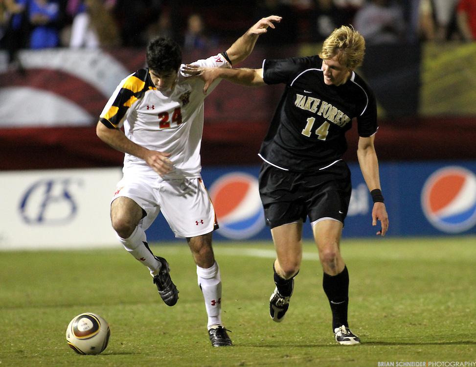 Oct 23, 2010; College Park, MD, USA; Maryland Terrapins defender Greg Young (24) against Wake Forest Demon Deacons midfielder Luke Norman (14). Mandatory Credit: Brian Schneider-www.ebrianschneider.com