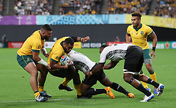 Australia's Samu Kerevi is tackled by Fiji's Levani Botia during the 2019 Rugby World Cup Pool D match at Sapporo Dome.