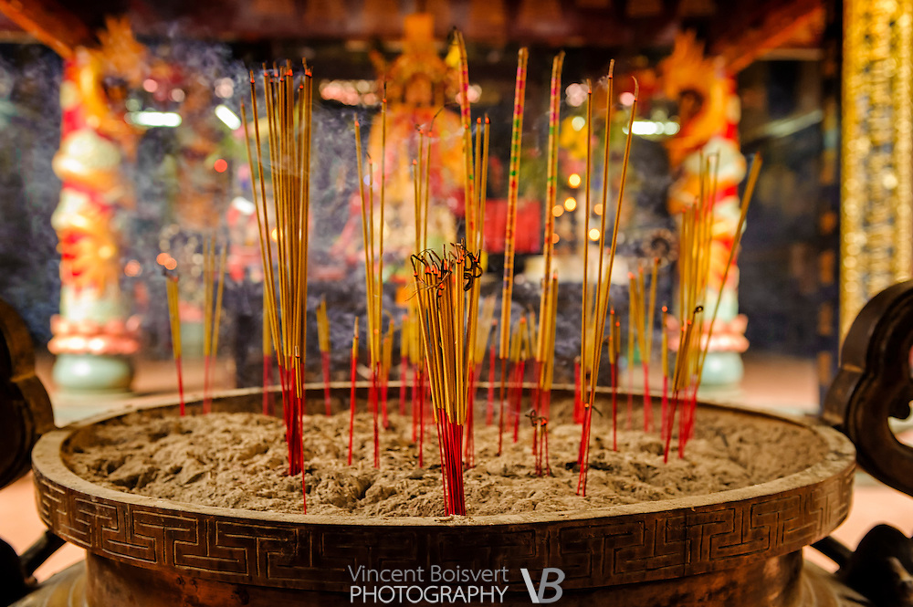 Incense stick burning in a Buddhist temple in Ho Chi Minh City, Vietnam.