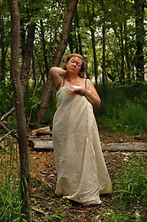 Luba Nikolaevich Glazyrin makes a mask of salmon eggs for her face that many here beleive is the secret to keep young looking skin and then takes a bath and a sauna at a camp along the banks of the river Vyvenka in Khailina, Kamchatka July 18, 2007.