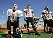 (033008 Somerville, MA)   The Independent Women's Football League's Boston Militia played Manchester Freedom in a scrimmage at the Dilboy Stadium in Somerville to get ready for their first game against the DC Divas April 12th.  Militia's quarterback Allison Cahill, 7,  Erin Lantry, 89, and Amanda Alpert, 50, watch the defense play.