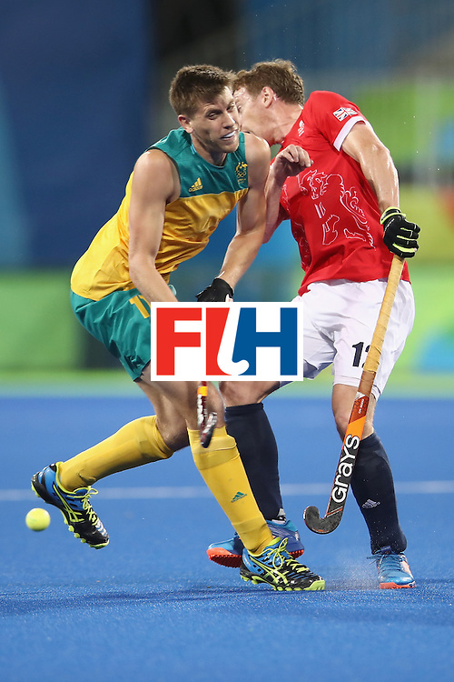 RIO DE JANEIRO, BRAZIL - AUGUST 10:  Eddie Ockenden of Australia and Michael Hoare of Great Britain collide during the men's pool A match between Great Britain and Australia on Day 5 of the Rio 2016 Olympic Games at the Olympic Hockey Centre on August 10, 2016 in Rio de Janeiro, Brazil.  (Photo by Mark Kolbe/Getty Images)