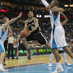 29 March 2009: San Antonio Spurs guard Tony Parker (9) drives between New Orleans Hornets defenders Sean Marks (4) and David West (30) during a 90-86 victory by the New Orleans Hornets over Southwestern Division rivals the San Antonio Spurs at the New Orleans Arena in New Orleans, Louisiana.