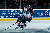 KELOWNA, CANADA - FEBRUARY 24:  Carson Denomie #34 of the Kamloops Blazers back checks Libor Zabransky #7 of the Kelowna Rockets during second period on February 24, 2018 at Prospera Place in Kelowna, British Columbia, Canada.  (Photo by Marissa Baecker/Shoot the Breeze)  *** Local Caption ***