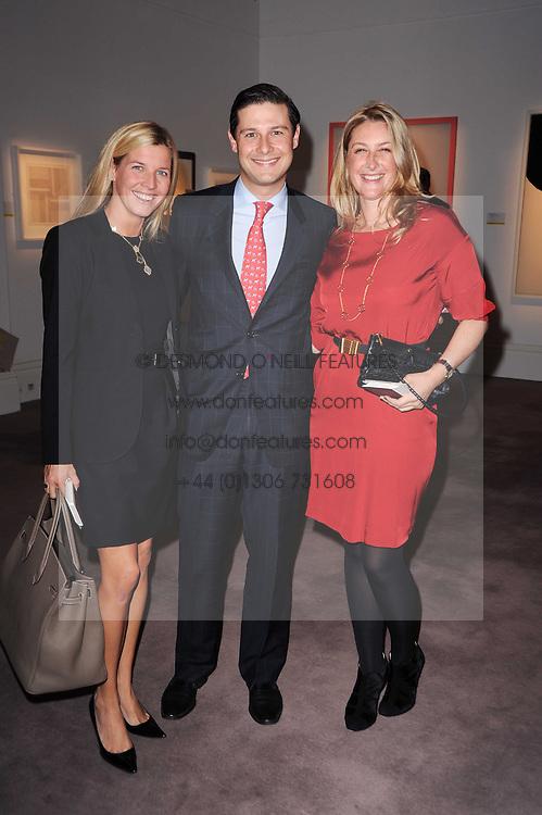 Left to right, Alexandra Vargas, Bernal Vargas and Georgina Cohen at the Krug Mindshare auction held at Sotheby's, New Bond Street, London on 1st November 2010.