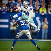 Dallas Cowboys running back Ezekiel Elliott leaps over Indianapolis Colts cornerback Pierre Desir during the first half of an NFL football game, Sunday, Dec. 16, 2018, in Indianapolis. Indianapolis won 23-0.