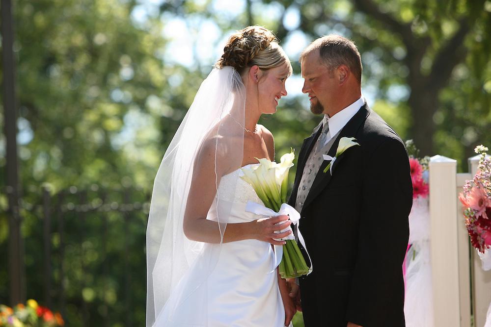 Heidi and Bradon Atkinson get married at the David B. Haight home at Utah State University in Logan, Utah on July 14, 2006. August Miller<br />