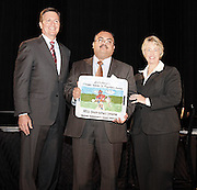 HISD Chief Operating Officer Leo Bobadilla (center) accepts the J. Howard Rambin III Founder's Award on Monday, Oct. 28, 2013, during the Mayor's Proud Partners Luncheon. The award was presented by Jim Tates (left), chairman of the Houston Clean Commission, and Houston Mayor Annise Parker for HISD's Green Building Initiative.