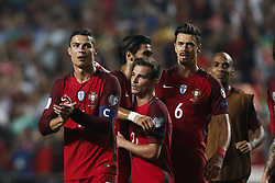 October 10, 2017 - Lisbon, Portugal - Portugal's forward Cristiano Ronaldo  (L)  and Portugal's midfielder Andre Gomes, Portugal's defender Cedric Soares, Portugal's defender Jose Fonte and Portugal's defender Joao Mario (R) celebrate after winning against  during the FIFA World Cup WC 2018 football qualifier match between Portugal and Switzerland, in Lisbon, on October 10, 2017. (Credit Image: © Carlos Palma/NurPhoto via ZUMA Press)