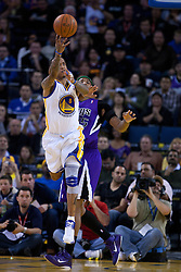 April 10, 2011; Oakland, CA, USA;  Golden State Warriors shooting guard Monta Ellis (8) grabs a rebound in front of Sacramento Kings power forward DeMarcus Cousins (15) during the first quarter at Oracle Arena. Sacramento defeated Golden State 104-103.