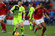 Huddersfield Town forward Harry Bunn and Nottingham Forest defender Michael Mancienne challenge for the ball during the Sky Bet Championship match between Nottingham Forest and Huddersfield Town at the City Ground, Nottingham, England on 13 February 2016. Photo by Aaron  Lupton.