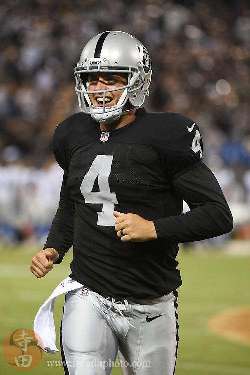 August 15, 2014; Oakland, CA, USA; Oakland Raiders quarterback Derek Carr (4) smiles during the second quarter against the Detroit Lions at O.co Coliseum.