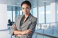Confident businesswoman standing in office corridor